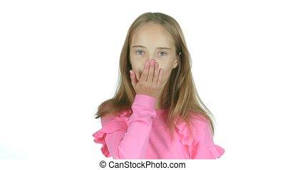 Child sends an air kiss. White background - Child sends an...