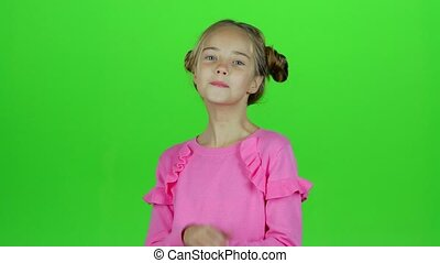 Child shows different emotions. Green screen - Child is sad,...