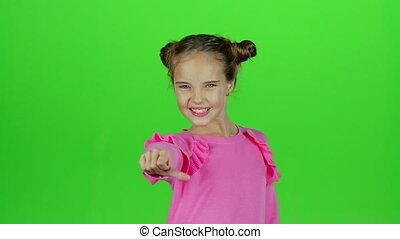 Child shows thumbs up. Green screen. Slow motion