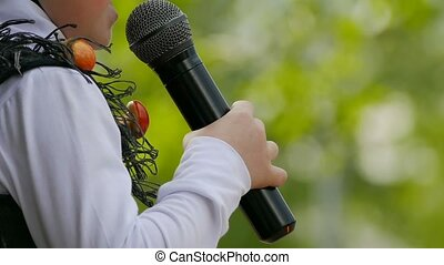 child singing into a microphone slow motion video