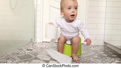 Child sits down and gets up from the chamberpot. Kid plays...