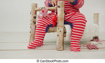 child sits on a small wooden bed