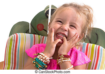 child sitting and laughing isolated on white