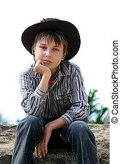 Child sitting and thinking
