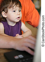 Child sitting at a laptop