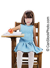 Child Sitting at School Desk - Little girl sitting at a...