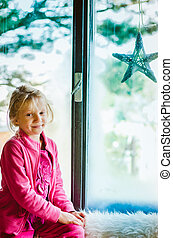 child sitting by the window
