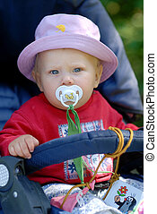 Child sitting in a pram