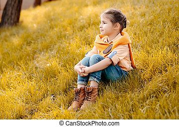 child sitting in park
