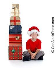 Child sitting near presents