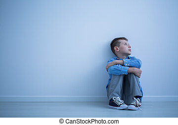Child sitting on a floor
