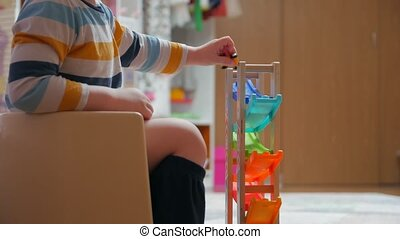Child sitting on a potty with toys childrens room home interior