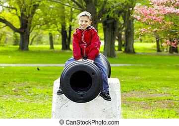 Child Sitting on Cannon