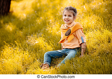 child sitting on grass