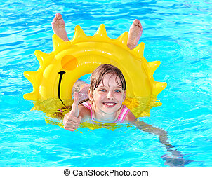 Child sitting on inflatable ring thumb up. - Children...