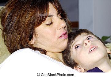 Child Sitting On Moms Lap