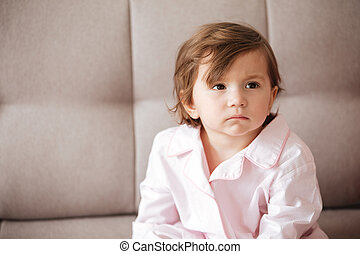 Child sitting on sofa
