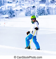 Child skiing in mountains
