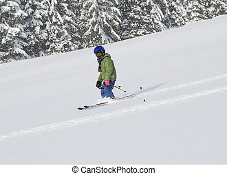 child skiing in powder snow