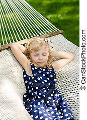 child sleeping in hammock