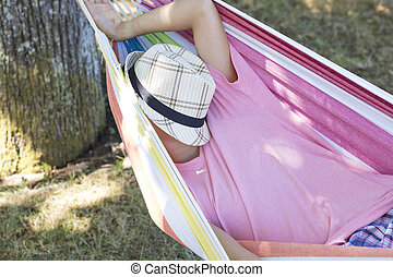 child sleeping in the hammock