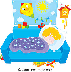 Little boy sleeping on his couch in a kids bedroom with toys