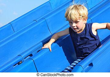Child Sliding at Playground