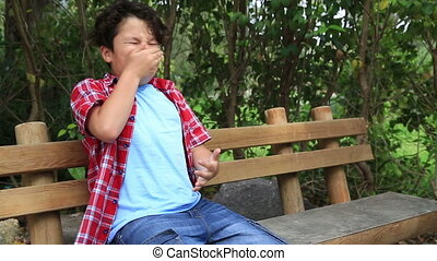 Child sneezing with hayfever allergy - Boy with allergic...