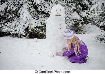 child, snowman and winter forest