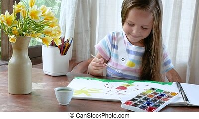 Child Soaking Paintbrush in To Color And Drawing near window...