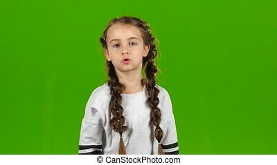 Child speaks into the loudspeaker. Green screen - Child...