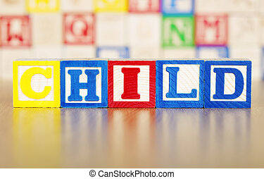 Child Spelled Out in Alphabet Building Blocks