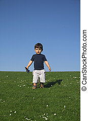 child standing in field