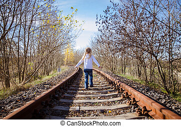 child standing in railway