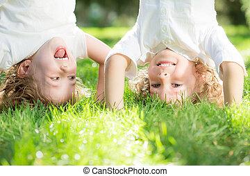 Child standing upside down - Happy children standing upside...