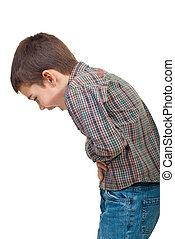 Child stomach ache - Child standing in profile having a...