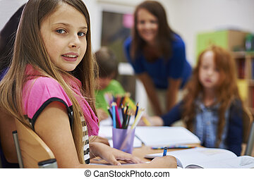 Child student sitting at her desk