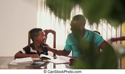 Child Studying Education With Father Helping Boy Doing School Homework