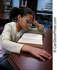 Child Studying in the Lib - African-American child studying...