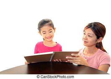 Child Studying with mother