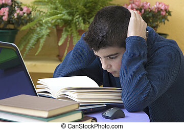 child studying with textbooks