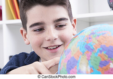 child studying with the globe at the college