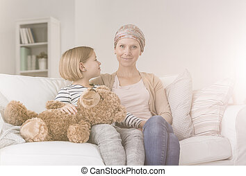 Child supporting mother with cancer
