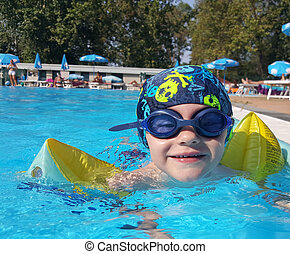 child swimming in the pool with armrests