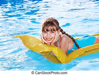 Child swimming on inflatable beach mattress. - Little girl...