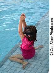 Child swimming pool lesson