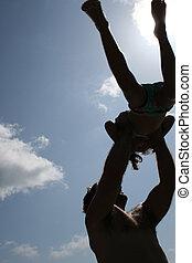 child swinging in air