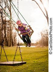 Child swings on seesaw