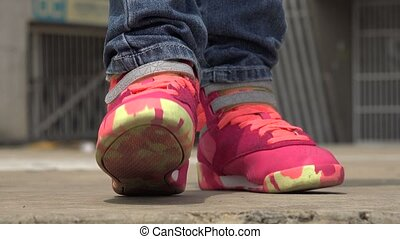 Child Tapping Her Foot to Beat