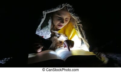 child teen and dog reading girl reads book at night with...